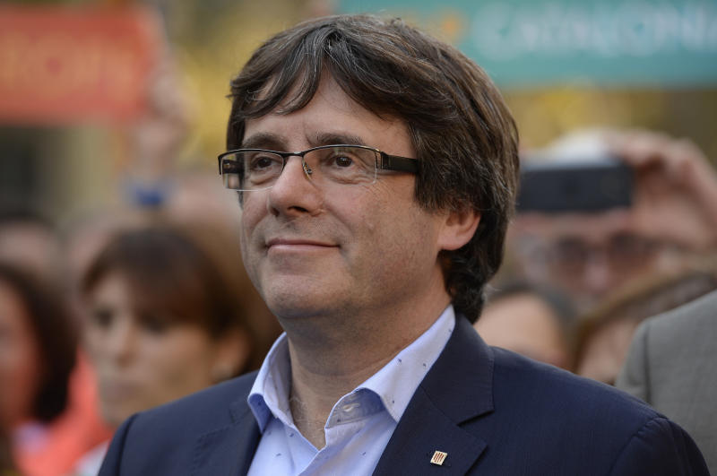 Carles Puigdemont attends a pro-independence demonstration on Oct. 21. (JOSEP LAGO via Getty Images)
