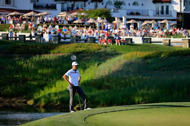 Justin Rose of England waits to putt during a playoff on the 18th green during the final round of the US PGA National on June 29, 2014 in Bethesda, Maryland (AFP Photo/Rob Carr)
