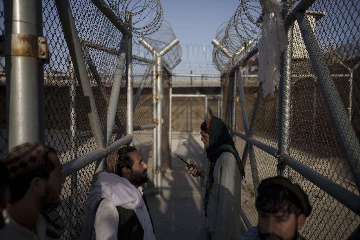 Taliban fighters enter an area where they are holding inmates who have been recently arrested at the Pul-e-Charkhi prison in Kabul, Afghanistan, Monday, Sept. 13, 2021. Pul-e-Charkhi was previously the main government prison for holding captured Taliban and was long notorious for abuses, poor conditions and severe overcrowding with thousands of prisoners. Now after their takeover of the country, the Taliban control it and are getting it back up and running, current holding around 60 people, mainly drug addicts and accused criminals. (AP Photo/Felipe Dana)