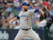 FILE PHOTO: Jul 28, 2018; Chicago, IL, USA; Toronto Blue Jays starting pitcher John Axford (77) throws a pitch during the first inning against the Chicago White Sox at Guaranteed Rate Field. Mandatory Credit: Dennis Wierzbicki-USA TODAY Sports