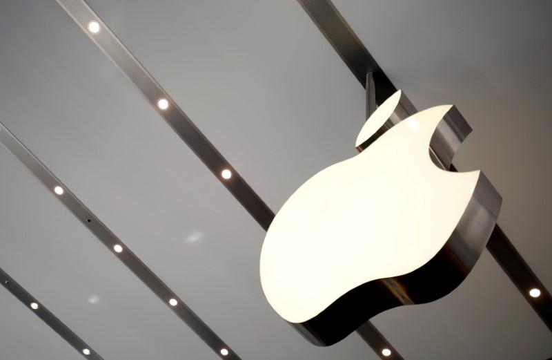 FILE PHOTO: Apple logo is pictured inside the newly opened Omotesando Apple store at a shopping district in Tokyo, Japan