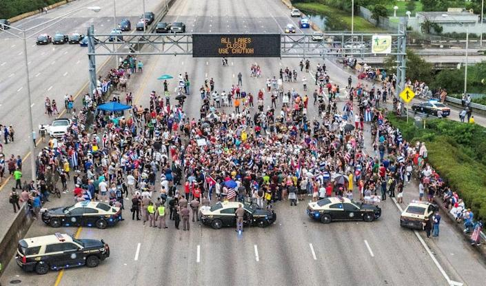 Cuban exiles blocked the Palmetto Expressway north and south bound at Coral Way in support of protesters in Cuba as thousands of Cubans took to the streets in the island to complain about a lack of freedom and a worsening economic situation, on Tuesday 13, 2021.