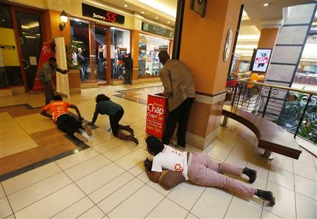 People scramble for safety as armed police hunt gunmen who went on a shooting spree at Westgate shopping centre in Nairobi, September 21, 2013. REUTERS/Goran Tomasevic