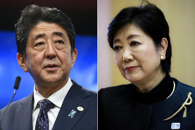 Japan's Prime Minister Shinzo Abe (L) is poised for a comfortable victory over Yuriko Koike (AFP Photo/JOHN THYS, BEHROUZ MEHRI)