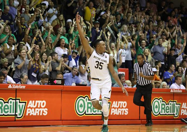 "<a class=""link rapid-noclick-resp"" href=""/ncaab/players/126186/"" data-ylk=""slk:Bonzie Colson"">Bonzie Colson</a> celebrates after hitting a 3-pointer in his team's one-point win. (Photo by Darryl Oumi/Getty Images)"