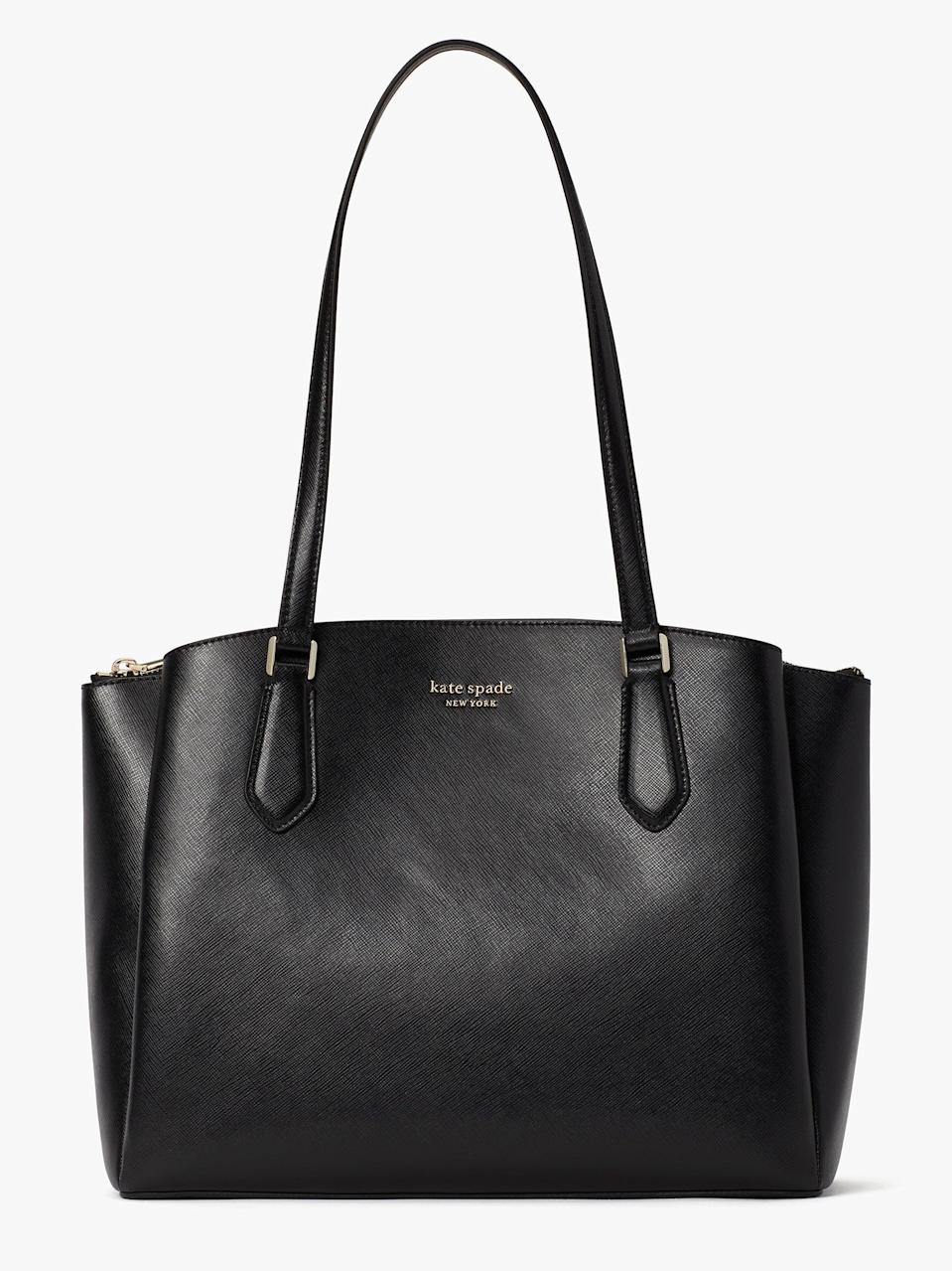 """<h2>Kate Spade</h2><br><strong>Sale:</strong> Up to 60% off sale styles<br><strong>Dates:</strong> Now - January 18 11:59pm<br><strong>Promo Code:</strong> THISISIT<br><br><em>Shop</em> <strong><em><a href=""""http://katespade.com"""" rel=""""nofollow noopener"""" target=""""_blank"""" data-ylk=""""slk:Kate Spade"""" class=""""link rapid-noclick-resp"""">Kate Spade</a></em></strong><br><br><strong>Kate Spade</strong> Booked Large Work Tote, $, available at <a href=""""https://go.skimresources.com/?id=30283X879131&url=https%3A%2F%2Fwww.katespade.com%2Fproducts%2Fbooked-large-work-tote%2FPXR00332.html"""" rel=""""nofollow noopener"""" target=""""_blank"""" data-ylk=""""slk:kate spade"""" class=""""link rapid-noclick-resp"""">kate spade</a>"""