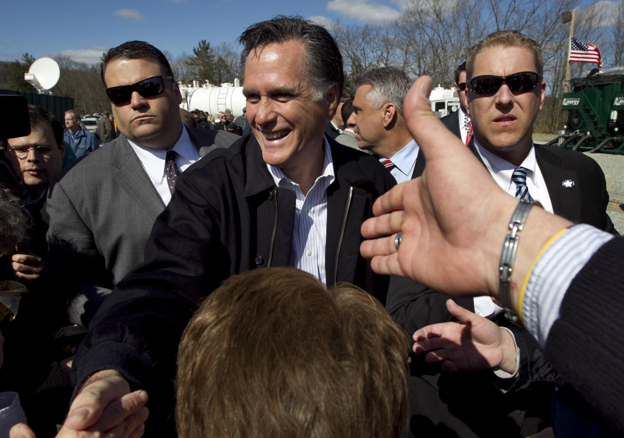 Republican presidential candidate, former Massachusetts Gov. Mitt Romney greets people in the crowd following a campaign event at an energy services company in Tunkhannock, Pa.., Thursday, April 5, 2012. (AP Photo/Steven Senne)