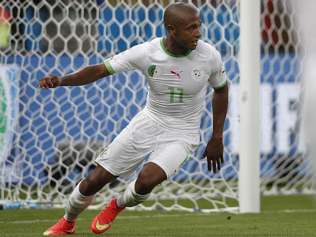 Algeria's midfielder Yacine Brahimi celebrates scoring during a Group H football match between South Korea and Algeria at the Beira-Rio Stadium in Porto Alegre during the 2014 FIFA World Cup on June 22, 2014 (AFP Photo/Adrian Dennis)