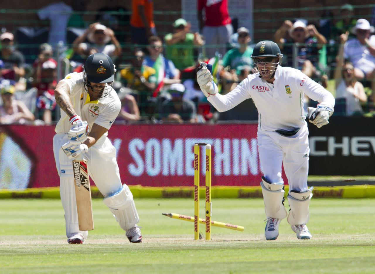 South Africa's AB de Villiers reacts as Australia's Mitchell Johnson is bowled during the third day of their second cricket test match in Port Elizabeth February 22, 2014. REUTERS/Rogan Ward (SOUTH AFRICA - Tags: SPORT CRICKET)