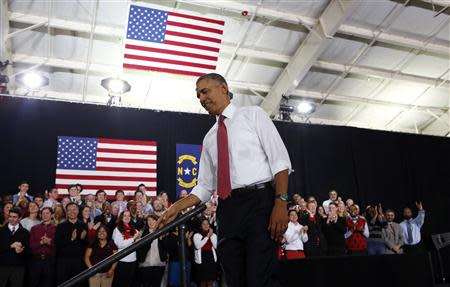 U.S. President Barack Obama steps from the platform after speaking at North Carolina State University in Raleigh January 15, 2014. REUTERS/Kevin Lamarque