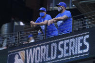 Los Angeles Dodgers fans watch batting practice before Game 2 of the baseball World Series against the Tampa Bay Rays Wednesday, Oct. 21, 2020, in Arlington, Texas. (AP Photo/Eric Gay)
