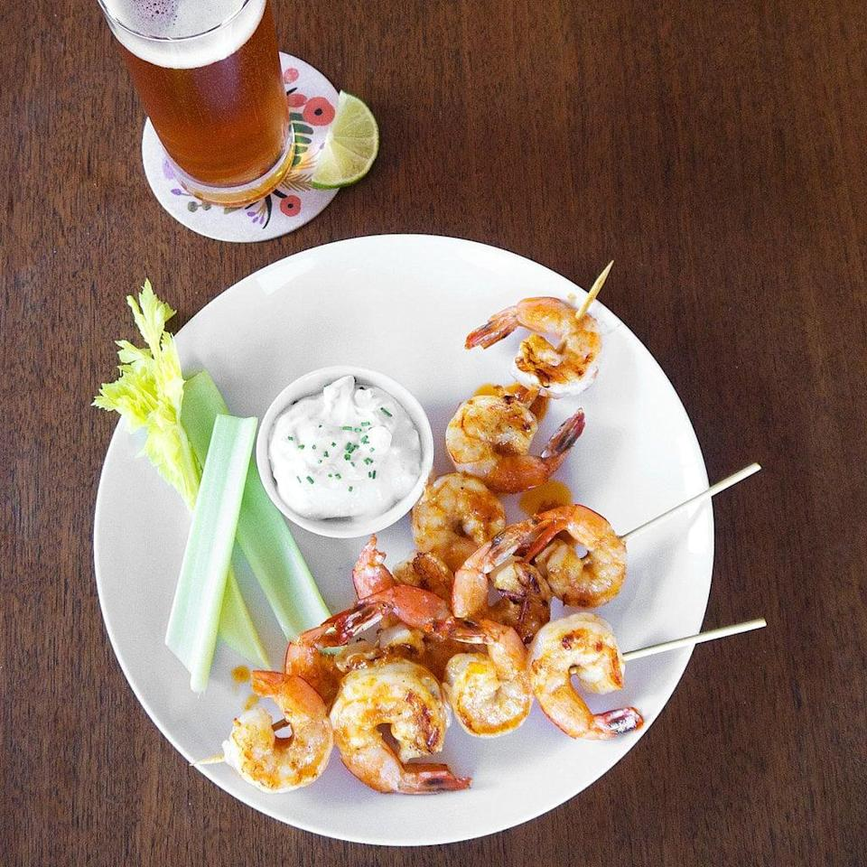 """<p>There's nothing more game-stopping than this spin on grilled shrimp. With bold flavors and the perfect mix of savory and sweet, these skewers will go fast. Enjoy them with your favorite dip for best results.</p> <p><strong>Get the recipe:</strong> <a href=""""http://www.popsugar.com/food/Buffalo-Shrimp-Recipe-4140709/"""" class=""""link rapid-noclick-resp"""" rel=""""nofollow noopener"""" target=""""_blank"""" data-ylk=""""slk:grilled buffalo shrimp"""">grilled buffalo shrimp</a> </p>"""
