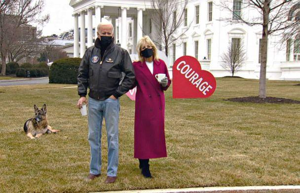PHOTO: First lady Jill Biden and President Joe Biden look at the Valentines Jill Biden had installed overnight on the White House lawn, early Feb. 12, 2021. (ABC)