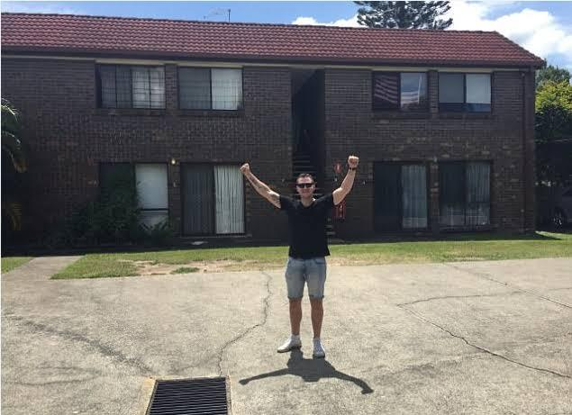 Eddie Dilleen standing in front of one of his apartments.