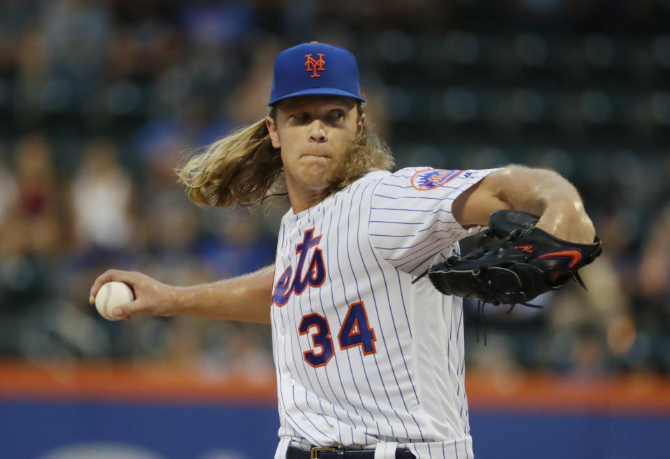 New York Mets' Noah Syndergaard delivers a pitch during the first inning of the team's baseball game against the San Francisco Giants on Wednesday, Aug. 22, 2018, in New York. (AP Photo/Frank Franklin II)