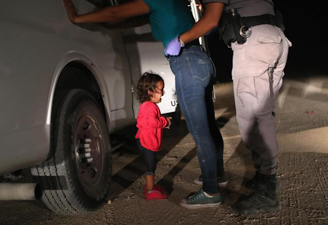 "<p>A two-year-old Honduran asylum seeker cries as her mother is searched and detained near the U.S.-Mexico border on June 12, 2018 in McAllen, Texas. The asylum seekers had rafted across the Rio Grande from Mexico and were detained by U.S. Border Patrol agents before being sent to a processing center for possible separation. Customs and Border Protection (CBP) is executing the Trump administration's ""zero tolerance"" policy towards undocumented immigrants. U.S. Attorney General Jeff Sessions also said that domestic and gang violence in immigrants' country of origin would no longer qualify them for political asylum status. (Photo: John Moore/Getty Images) </p>"