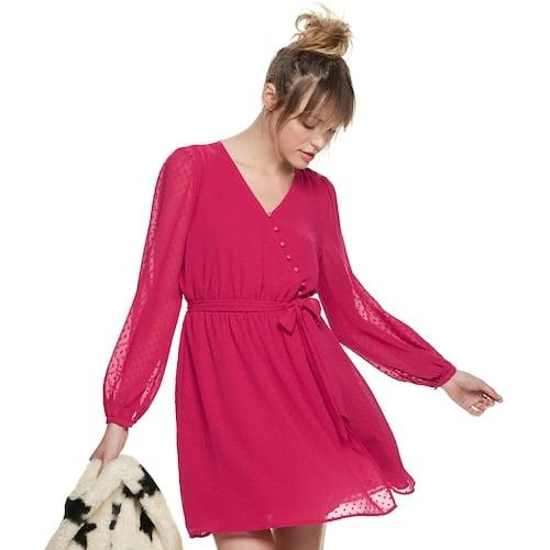 "<p><a href=""https://www.popsugar.com/buy/POPSUGAR-Surplice-Mini-Dress-526136?p_name=POPSUGAR%20Surplice%20Mini%20Dress&retailer=kohls.com&pid=526136&price=58&evar1=fab%3Aus&evar9=46969149&evar98=https%3A%2F%2Fwww.popsugar.com%2Ffashion%2Fphoto-gallery%2F46969149%2Fimage%2F46969238%2FPOPSUGAR-Surplice-Mini-Dress&prop13=mobile&pdata=1"" rel=""nofollow"" data-shoppable-link=""1"" target=""_blank"" class=""ga-track"" data-ga-category=""Related"" data-ga-label=""https://www.kohls.com/product/prd-3940224/womens-popsugar-surplice-mini-dress.jsp?color=Granita&amp;prdPV=3"" data-ga-action=""In-Line Links"">POPSUGAR Surplice Mini Dress</a> ($58)</p>"