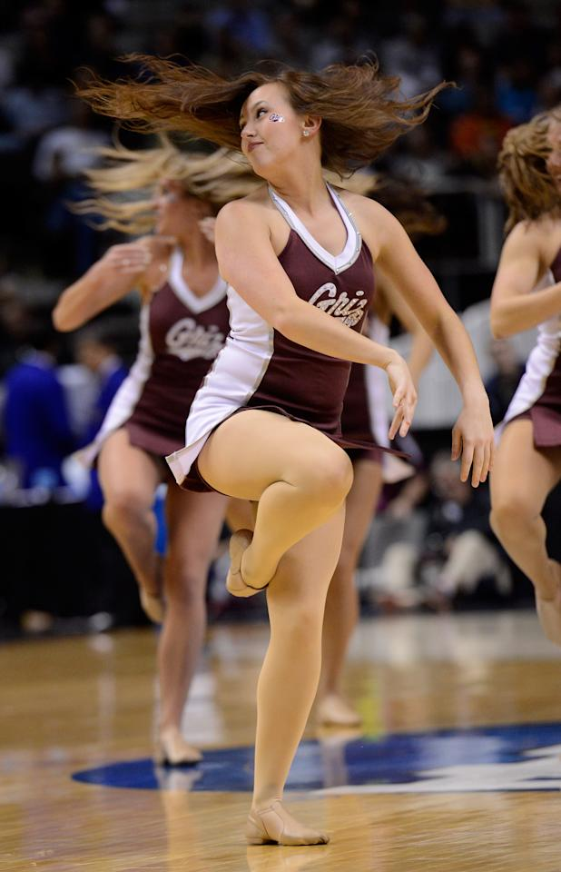 The Montana Grizzlies cheerleaders perform on the court during a game stoppage in the first half against the Syracuse Orange during the second round of the 2013 NCAA Men's Basketball Tournament at HP Pavilion on March 21, 2013 in San Jose, California.