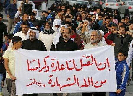 """Protesters holding a banner saying """"Death is normal to us and our dignity from God is martyrdom"""" take part in a protest against the execution of Saudi Shi'ite cleric Nimr al-Nimr by Saudi authorities, in the village of Sanabis, west of Manama, Bahrain January 2, 2016. REUTERS/Hamad I Mohammed"""
