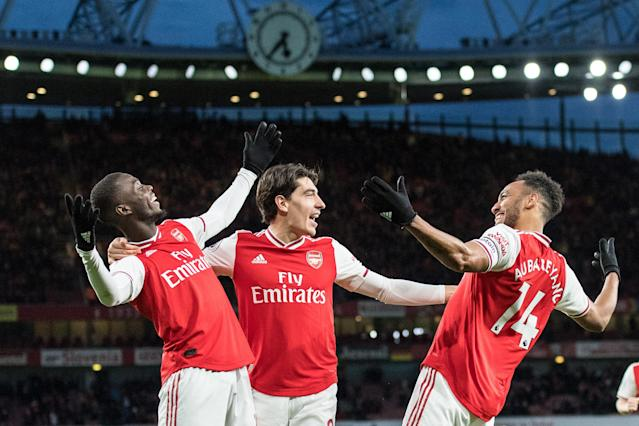 Arsenal's Pierre-Emerick Aubameyang (right) celebrates his winning goal with teammates Nicolas Pépé (left) and Héctor Bellerín on Sunday. (Photo by Sebastian Frej/MB Media/Getty Images)
