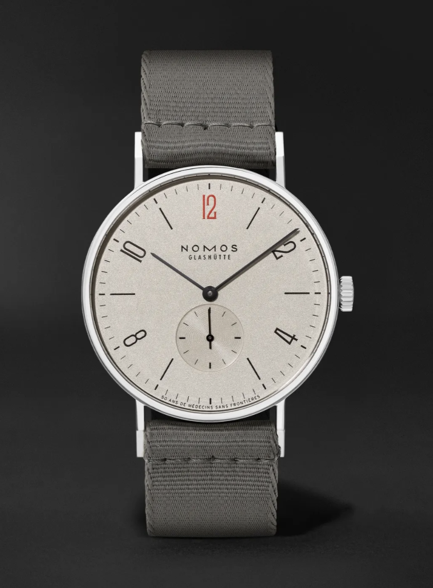 """<p><strong>NOMOS GLASHÜTTE</strong></p><p>mrporter.com</p><p><strong>$2030.00</strong></p><p><a href=""""https://go.redirectingat.com?id=74968X1596630&url=https%3A%2F%2Fwww.mrporter.com%2Fen-us%2Fmens%2Fproduct%2Fnomos-glashuette%2Fluxury-watches%2Fdress-watches%2Ftangente-38-limited-edition-hand-wound-375mm-stainless-steel-and-canvas-watch-ref-no-165s50%2F17411127375751699&sref=https%3A%2F%2Fwww.townandcountrymag.com%2Fstyle%2Fjewelry-and-watches%2Fg14418271%2Fbest-mens-luxury-watches%2F"""" rel=""""nofollow noopener"""" target=""""_blank"""" data-ylk=""""slk:Shop Now"""" class=""""link rapid-noclick-resp"""">Shop Now</a></p><p>With a wide, clean face and a gray canvas strap, this watch reflects Nomos Glashutte's comparatively young (the house was founded in 1990) start in the watchmaking world. </p><p>Case size: 37.5mm</p>"""
