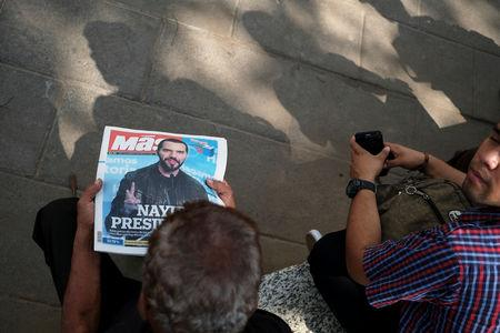 A man reads a newspaper with the picture of presidential candidate Nayib Bukele, who proclaimed himself the winner of the presidential election, in San Salvador, El Salvador, February 4, 2019. REUTERS/Jose Cabezas