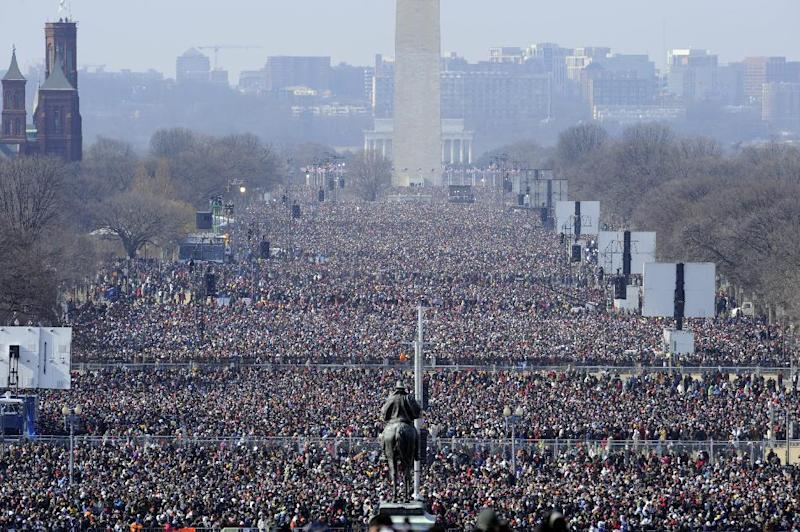 FILE - This Jan. 20, 2009 file photo shows the crowd on the National Mall looking from the Capitol toward the Washington Monument and Lincoln Memorial listening to the inaugural address of President Barack Obama. While Washington won't likely see the record-setting turnout from the last inauguration, officials are planning for a bigger-than-average crowd making plans for a second chance to see a president's swearing in. District of Columbia officials have pieced together early data projecting 600,000 to 800,000 people will crowd onto the National Mall on Jan. 21. That's based on past attendance and data including hotel and restaurant reservations and chartered buses. The inauguration is the biggest event every four years in the nation's capital, followed by July 4th celebrations. The 2009 inaugural drew 1.8 million. (AP Photo/Susan Walsh, File)