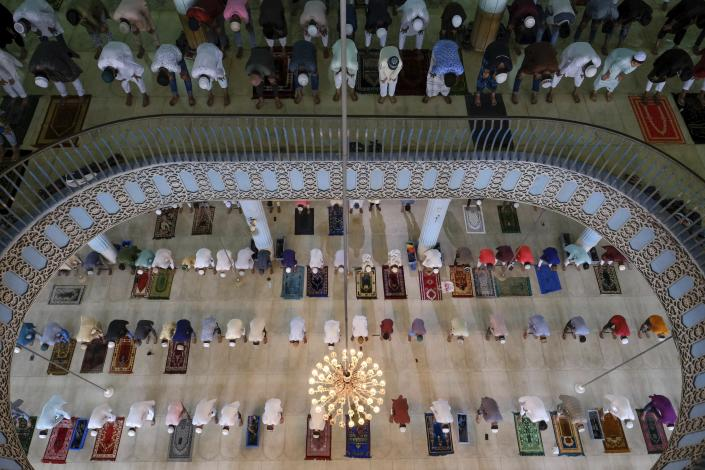 Muslims offer prayers on the morning of Eid-ul-Adha at Baitul Mukarram National Mosque in Dhaka, Bangladesh, July 21, 2021. Eid al-Adha, or the Feast of the Sacrifice, is marked by sacrificing animals to commemorate the prophet Ibrahim's faith in being willing to sacrifice his son. (AP Photo/Mahmud Hossain Opu)