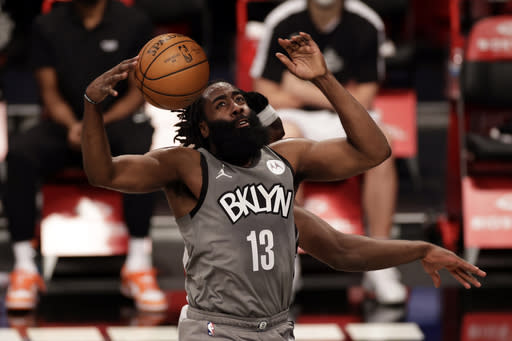 Brooklyn Nets guard James Harden reacts after dunking during the second half of an NBA basketball game against the Miami Heat, Monday, Jan. 25, 2021, in New York. (AP Photo/Adam Hunger)