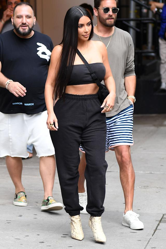 <p>In a black bandeau, matching sweatpants and reptile booties while out in New York City. </p>