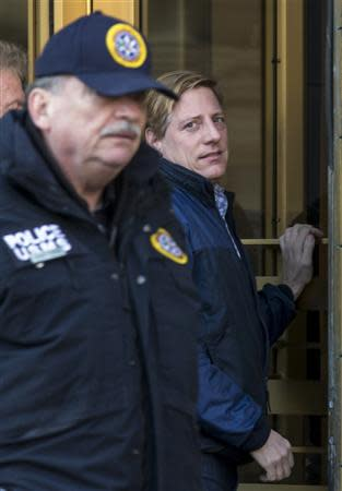 Dana Giacchetto (R) arrives at the Manhattan Federal Courthouse in New York February 20, 2014. REUTERS/Brendan McDermid