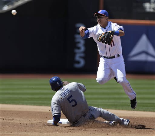 New York Mets shortstop Ruben Tejada, right, turns a double play over Los Angeles Dodgers' Juan Uribe during the fifth inning of the baseball game at Citi Field, Thursday, April 25, 2013, in New York. (AP Photo/Seth Wenig)
