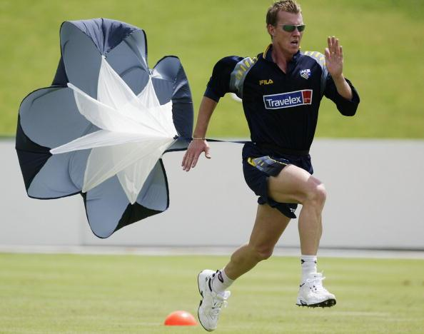 POTCHEFSTROOM - FEBRUARY 3:  Brett Lee of Australia runs with a parachute, during training at North West Stadium, Potchefstroom, South Africa, on February 3, 2003. (Photo by Hamish Blair/Getty Images)