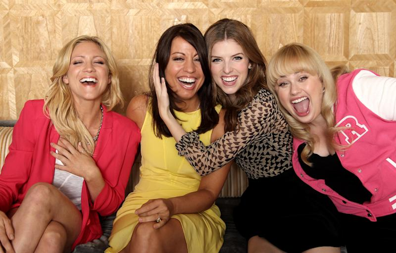 """In this image taken on Friday, Sept. 21, 2012, from left, actress Brittany Snow, screenwriter Kay Cannon, actress Anna Kendrick, actress Rebel Wilson, from the film """"Pitch Perfect,"""" pose for a portrait at The London Hotel, in West Hollywood, Calif. Funny women are flourishing in comedies that are produced and written by women. (Photo by Matt Sayles/Invision/AP)"""