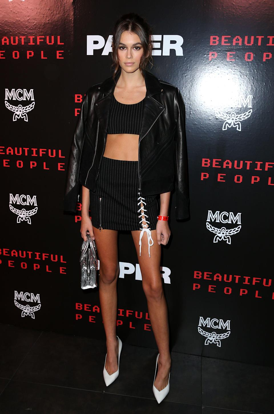 <p>Kaia worked a pinstriped two-piece and leather jacket at yet another NYFW party.<br><i>[Photo: Rex]</i> </p>