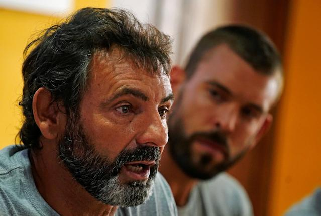 Oscar Camps, the founder of Spanish NGO Proactiva Open Arms, and Spanish basketball player Marc Gasol (R), who plays for NBA's Memphis Grizzlies, attend a news conference in Palma de Mallorca, Spain July 21, 2018. REUTERS/Juan Medina