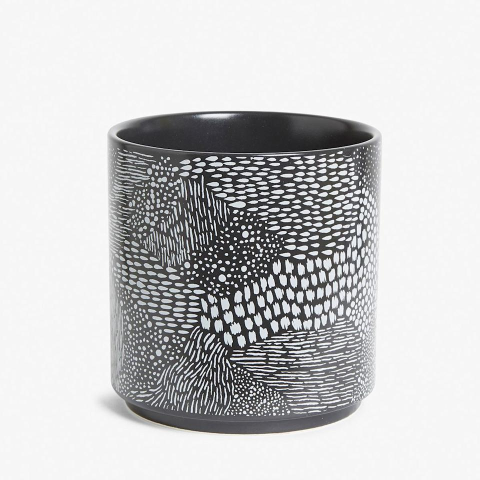 Put an air-purifying plant in this cute printed pot. Stylish and health-benefiting.