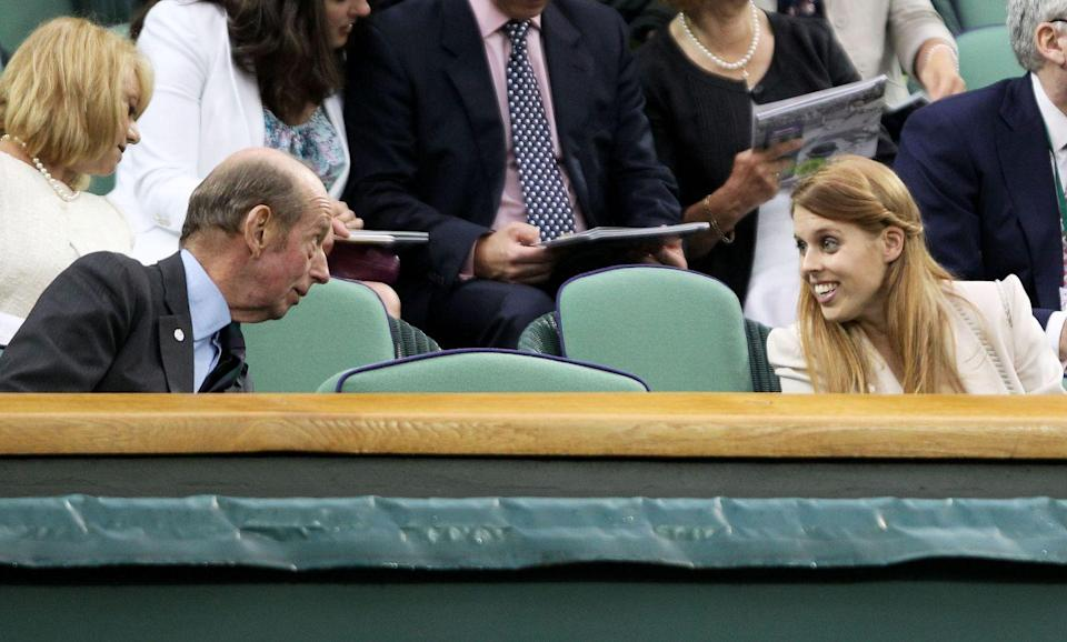<p>Princess Eugenie chats with Prince Edward, Duke of Kent, between matches.</p>
