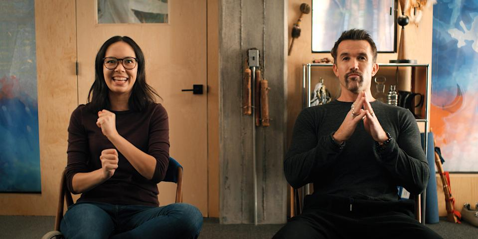"""Poppy (Charlotte Nicdao) and Ian (Rob McElhenney) are the platonic heart of Apple TV+'s workplace sitcom """"Mythic Quest."""""""