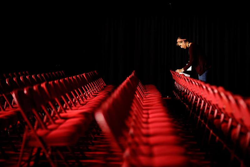 A volunteer prepares labels for seats in the debate hall ahead of the presidential debate, Tuesday, Oct. 2, 2012, at the University of Denver in Denver. President Barack Obama and Republican presidential candidate and former Massachusetts Gov. Mitt Romney will hold their first debate Wednesday. (AP Photo/David Goldman)