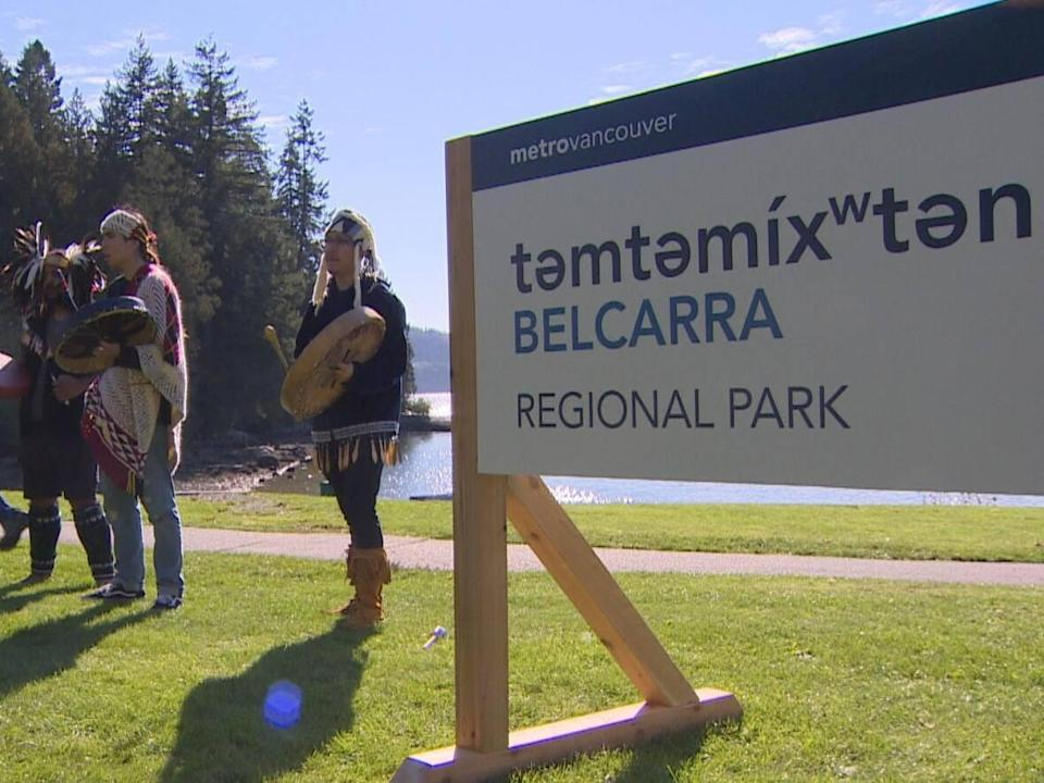 A new sign was unveiled during the ceremony donning the name təmtəmíxʷtən/Belcarra Regional Park. All other signages in the park will be changed in the next several months to reflect the name change.  (Ken Leedham/CBC - image credit)