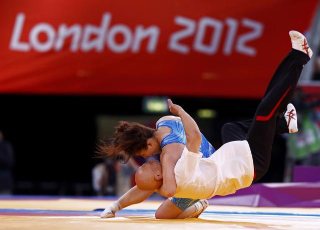 Japan's Saori Yoshida celebrates her victory over Canada's Tonya Lynn Verbeek on the final of the Women's 55Kg Freestyle wrestling at the ExCel venue during the London 2012 Olympic Games August 9, 2012. REUTERS/Grigory Dukor (BRITAIN - Tags: OLYMPICS SPORT WRESTLING TPX IMAGES OF THE DAY)