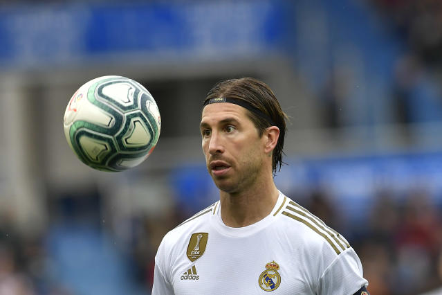 Real Madrid's Real Madrid's Sergio Ramos looks at the ball during the Spanish La Liga soccer match between Real Madrid and Alaves at Mendizorroza stadium, in Vitoria, northern Spain, Saturday, Nov. 30, 2019. (AP Photo/Alvaro Barrientos)