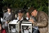 <p>Cate Blanchett, Spielberg, and Ford on the set of <em>Indiana Jones and The Kingdom Of The Crystal Skull</em> in 2008.</p>