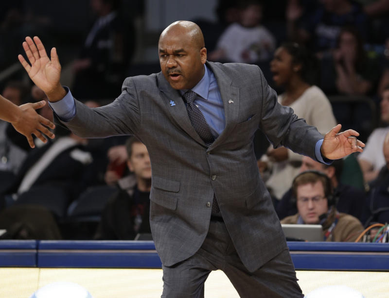 Georgetown head coach John Thompson III celebrates with a player during the first half of an NCAA basketball game against Michigan State at Madison Square Garden, Saturday, Feb. 1, 2014, in New York. (AP Photo/Seth Wenig)