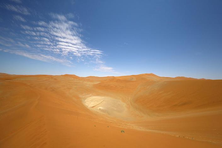 On top of Big Daddy dune at Sossusvlei in the Namib-Naukluft National Park of Namibia. The dune stands over 1,000 feet high, and it takes 45 minutes to climb its pitched angle route. (Photo: Gordon Donovan/Yahoo News)