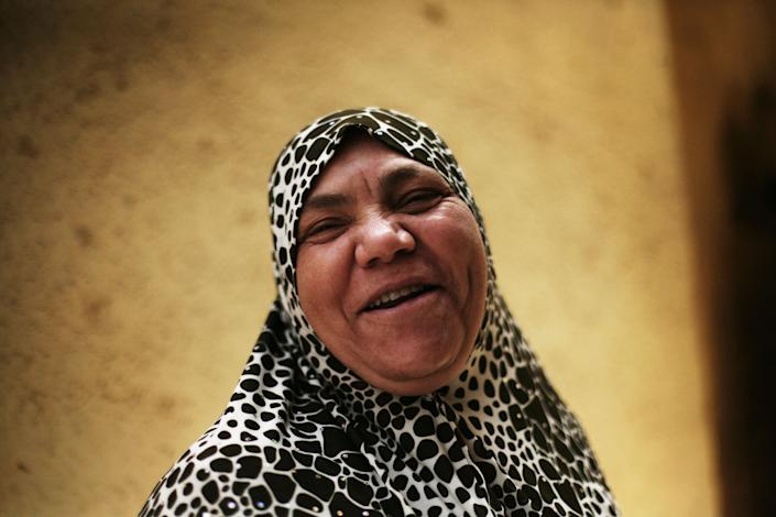 An Egyptian woman reacts after casting her vote inside a polling station in Cairo, Egypt, Thursday, May 24, 2012. Egyptians voted Thursday on the second day of a landmark presidential election that will produce a successor to longtime authoritarian ruler Hosni Mubarak. (AP Photo/Manu Brabo)