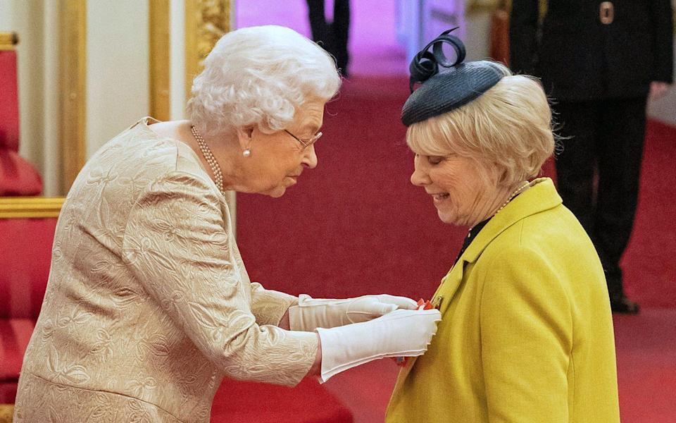 File photo dated 03/03/20 of Queen Elizabeth II wearing gloves as she awards the CBE to Miss Anne Craig, known professionally as actress Wendy Craig, during an investiture ceremony at Buckingham Palace in London. The Queen's upcoming visits to Cheshire and Camden have been postponed because of the coronavirus pandemic, Buckingham Palace has announced. PA Photo. Issue date: Friday March 13, 2020. See PA story ROYAL Queen. Photo credit should read: Dominic Lipinski/PA Wire - Dominic Lipinski/PA Wire