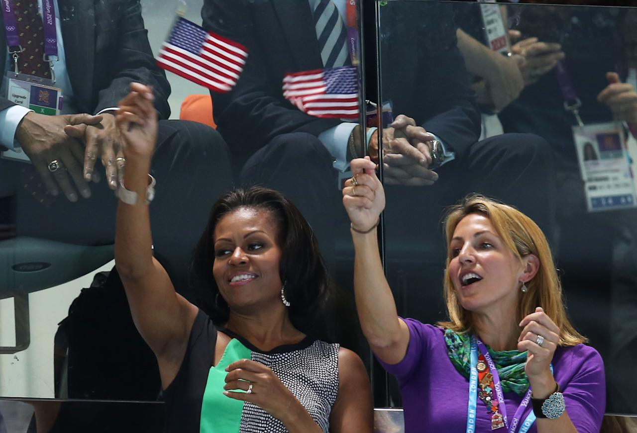 LONDON, ENGLAND - JULY 28:  First Lady of the United States, Michelle Obama supports the USA Olympic Swim team along with Summer Sanders durng the evening session of the swimming  on Day 1 of the London 2012 Olympic Games at the Aquatics Centre on July 28, 2012 in London, England.  (Photo by Clive Rose/Getty Images)
