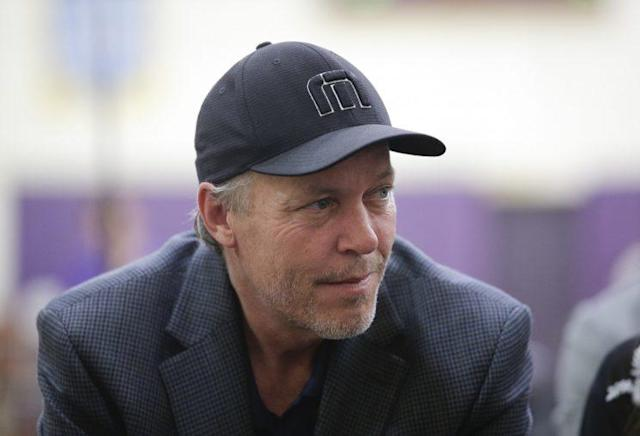 Jim Buss dons a dress cap at the introduction of D'Angelo Russell in 2015. (AP)
